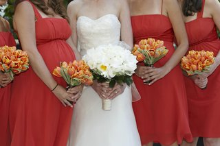 orange-tulip-bridesmaid-flowers-and-white-bridal-bouquet