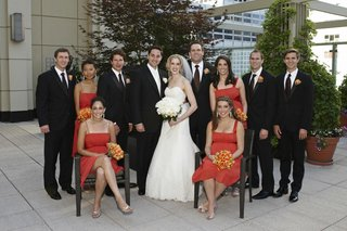 bride-and-groom-with-orange-bridesmaids-and-groomsmen