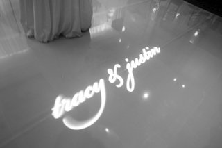black-and-white-photo-of-couples-names-projected-onto-dance-floor