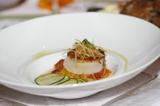 scallop-on-bed-of-yellow-and-orange-sauce