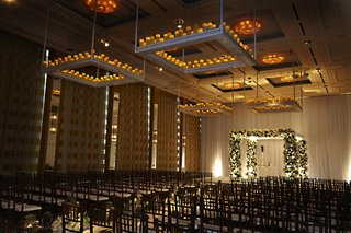square-platforms-with-candles-hanging-from-wedding-ceiling