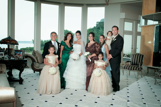 flower-girls-and-bride-in-tiered-ball-gowns-with-family