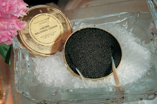 osetra-malossol-caviar-in-ice-bucket-next-to-pink-flowers