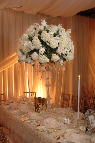 tall-centerpiece-of-white-hydrangea-bunches-on-crystal-candle-holder