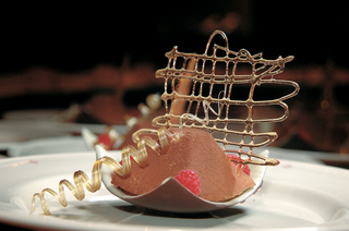 chocolate-dessert-with-raspberry-and-gold-sugar-garnish
