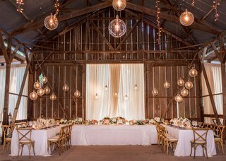 wedding-venue-dos-pueblos-ranch-barn-santa-barbara-area-glass-orb-pendants-u-shape-table-x-chairs