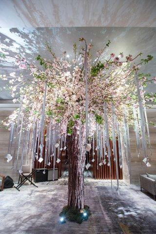 cherry-tree-escort-card-display-ribbons-modern-garden-new-york-wedding-indoors-uplighting-jewish