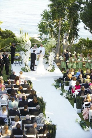 wedding-ceremony-on-bluff-over-ocean-with-bamboo-details