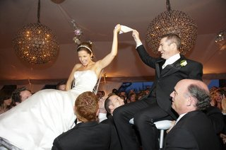 bride-and-groom-doing-hora-wedding-chair-dance