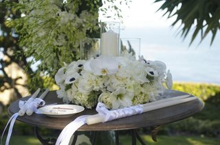 candle-altar-table-at-oceanfront-wedding-ceremony