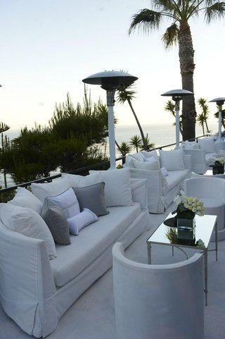lounge-area-at-reception-with-ocean-views-and-white-furniture
