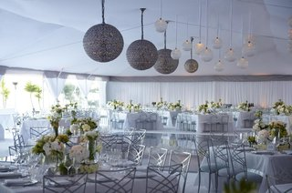 tent-wedding-with-globe-lights-and-white-flower-decorations