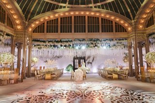 flower-print-wall-in-back-of-reception-gold-dance-floor-hanging-roses-white-gold-accents-new-york
