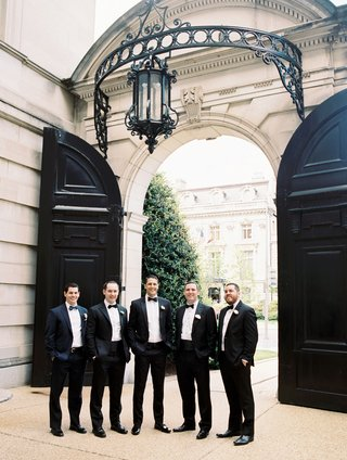 groom-with-friends-and-family-all-in-tuxedos-and-bow-ties-at-luxe-venue-in-washington-dc