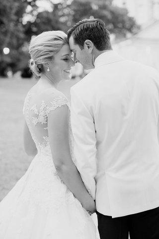 black-and-white-eskimo-kiss-bridal-wedding-portrait-groom-bride-romona-keveza-wedding-dress