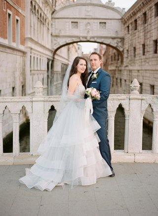 wedding-portrait-bride-in-hayley-paige-horsehair-wedding-dress-crystal-bodice-veil-bouquet-venice