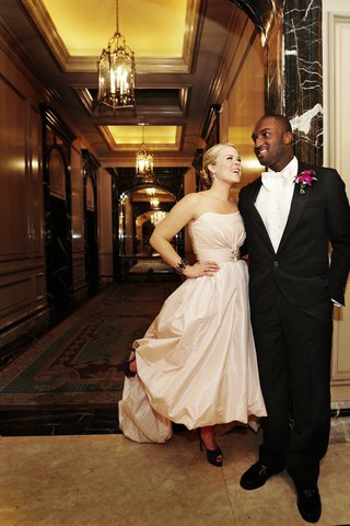 bride-in-a-strapless-amsale-gown-with-groom-in-a-black-tuxedo-at-the-four-seasons-hotel-chicago