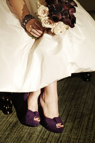 bride-in-a-pale-pink-gown-and-purple-louboutin-heels-holds-a-bouquet