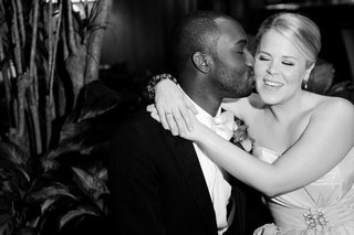 black-and-white-photo-of-groom-kissing-bride
