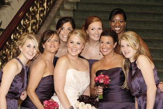 bride-in-a-strapless-amsale-gown-with-bridesmaids-in-dark-purple-dresses