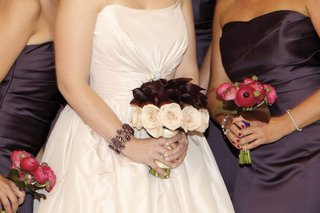 brides-bouquet-of-maroon-calla-lilies-and-pink-roses-with-bridesmaids-bouquets-of-fuchsia-roses