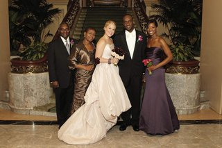 bride-in-a-high-low-amsale-gown-with-groom-in-black-tuxedo-and-family