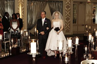 bride-in-a-pale-pink-amsale-gown-and-veil-walks-down-the-aisle-with-father-in-a-black-tuxedo-and-tie
