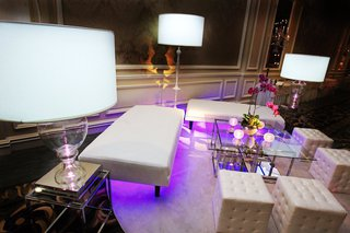 wedding-lounge-area-with-modern-white-furnishings-and-purple-lighting