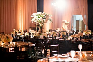 black-and-white-decor-white-and-green-floral-arrangements-branch-risers-lighting