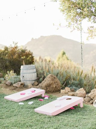 megan-nicole-youtube-singer-wedding-malibu-outdoor-cocktail-hour-cornhole-game-entertainment-pink