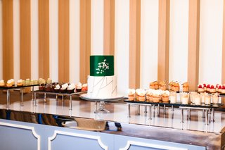 modern-wedding-dessert-table-two-tier-wedding-cake-with-emerald-layer-small-gourmet-desserts
