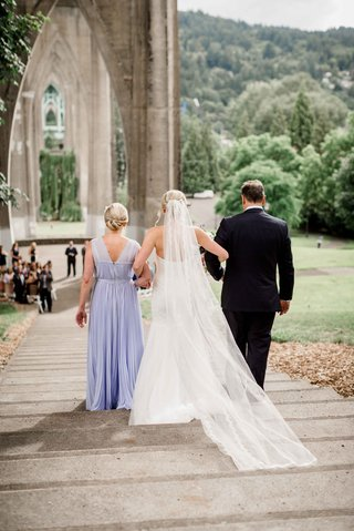 brides-parents-walk-her-down-steps-aisle-altar-portland-park-outdoor-wedding-lavender-dress-veil