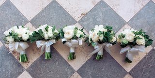 bridesmaid-bouquets-with-white-ranunculus-and-rose-flowers
