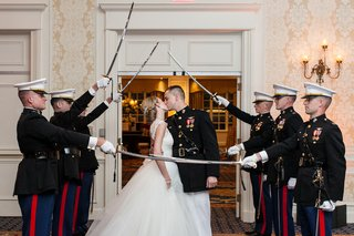 bride-and-groom-kiss-in-tunnel-of-swords-us-marine-corps