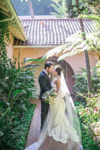 bride-and-groom-portrait-at-hotel-bel-air-bride-in-oscar-de-la-renta-strapless-ruffle-gown