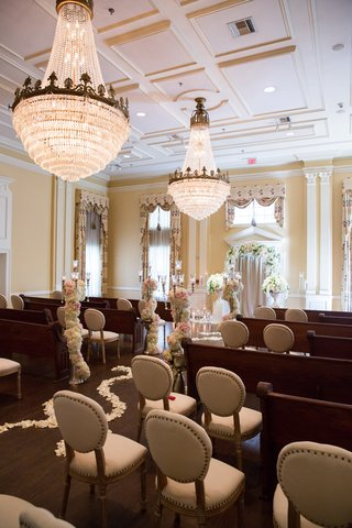 wedding-ceremony-seating-with-a-mix-of-old-fashioned-pews-and-cushioned-chairs