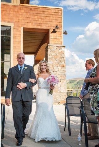 bride-walking-down-aisle-at-mountain-lodge-in-big-sky-montana
