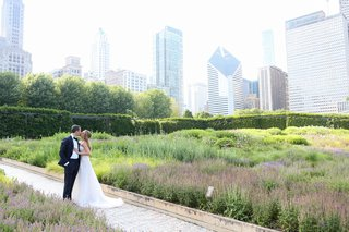 wedding portrait photo bride and groom in green meadow city skyline chicago illinois