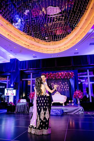indian-american-couple-in-reception-clothes-bride-in-indian-dress-groom-in-armani-suit