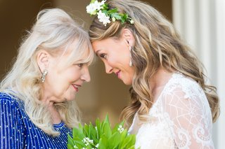 bride-mom-forehead-pose-sweet-daughter-mother-of-the-bride-flower-crown-blue-dress-earrings
