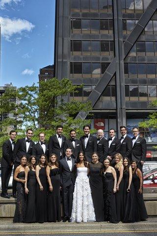 bride-in-oscar-de-la-renta-groom-in-j-hilburn-bridesmaids-in-mismatched-black-dresses