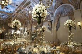 handpainted-ceiling-in-ballroom-with-large-flower-centerpieces