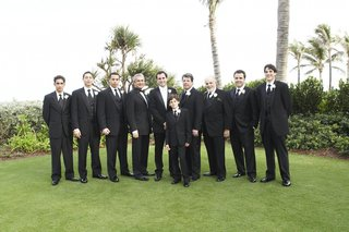 groom-with-male-attendants-on-the-breakers-lawn