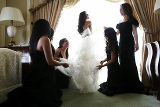 bridal-suite-getting-ready-shot-in-front-of-window