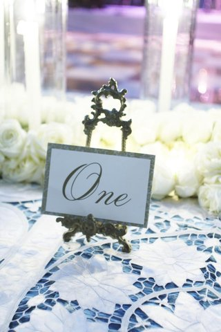 romantic-gold-place-cards-on-antique-stands