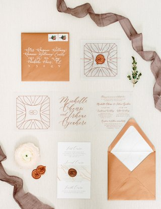 invitation-suites-with-copper-envelopes-wax-seals-clear-inserts