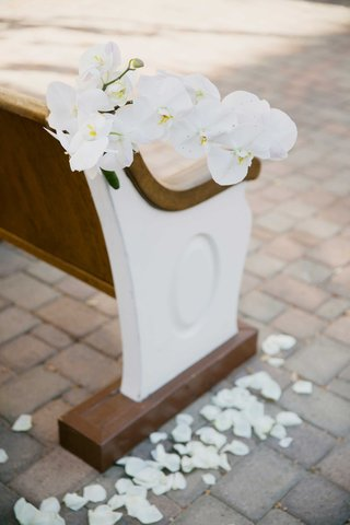 white-orchids-accent-ceremony-pew-bench-seating