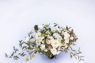 loosely-structured-bouquet-with-white-roses-peonies-greenery-magnolia-leaves