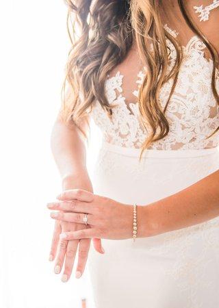bride-in-crepe-pronovias-wedding-dress-with-illusion-bodice-nude-manicure-nails-pearl-bracelet