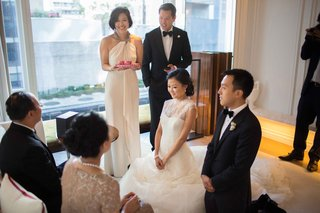 bride-and-groom-kneeling-during-traditional-chinese-tea-wedding-ceremony-before-other-ceremony